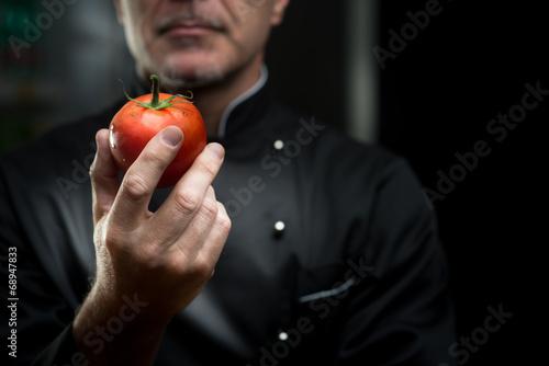 Chef holding a tomato - 68947833