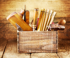 old tools in a wooden box