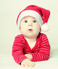 Happy New Year baby in Santa hat, Christmas concept