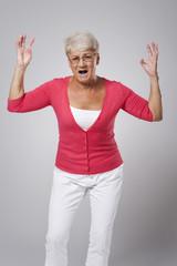 Stressed senior woman screaming very loud