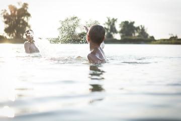 friends having fun in a lake