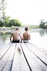 Children on a dock at a lake