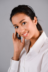 portrait of cheerful young brunette operator customer support