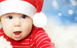 Surprised baby in Santa hat having fun, Christmas and Happy New