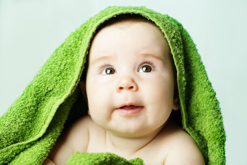 Happy baby with bath towel
