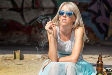 Young urban girl smoking cigarette
