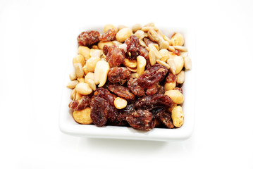 Raisins and Nuts in a White Square Bowl