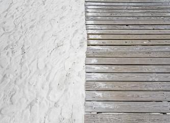 Wooden boardwalk through the sand.