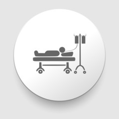 man resting at hospital bed