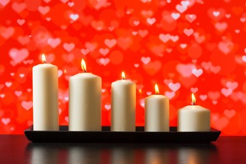 white candles on wood table valentine day concept