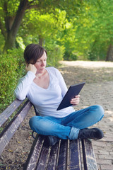 Woman reading E-book on digital tablet computer