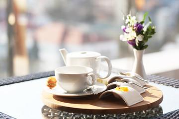 Tea pot with flower decoration