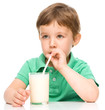 Cute little boy with a glass of milk