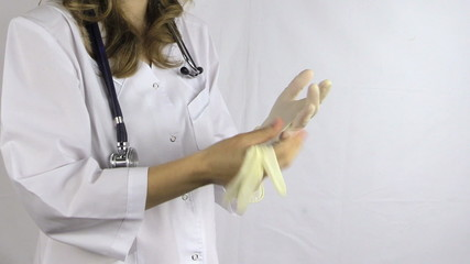 doctor woman in robe with stethoscope tool take off rubber glove