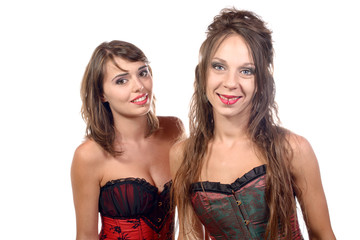two young women dressed in a corset