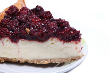 piece of cheesecake with blackberries