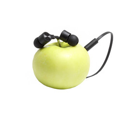 Ripe green apple in which headphones