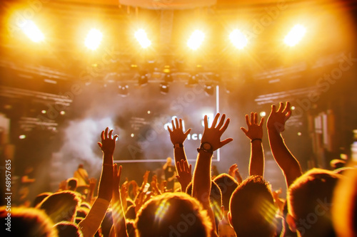 Cheering crowd in front of bright stage lights - 68957635