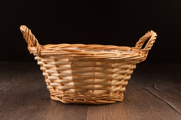 Wicker basket isolated on dark background