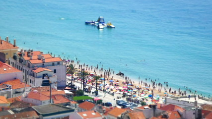 Miniature Time Lapse of People Moving on Beach, Portugal