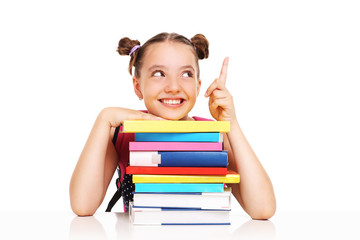 Schoolgirl with books pointing at something
