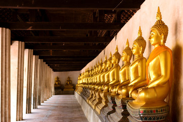 Row of sacred Buddha images in Putthaisawan Temple, located at A