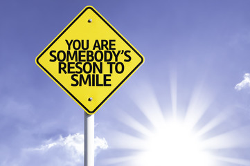 You Are Somebody's Reason to Smile road sign