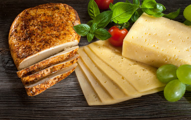Different types of cheese over old wooden table