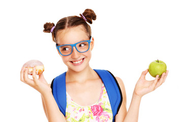 Schoolgirl with healthy and unhealthy lunch choices