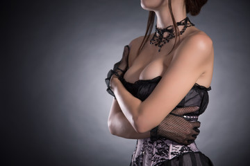 Busty woman in elegant pink and black corset
