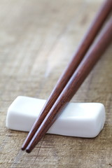 Close - up brown wooden chopsticks on table wood background