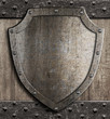 Leinwanddruck Bild - medieval shield on wooden gate