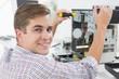 Leinwanddruck Bild - Young technician working on broken computer