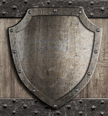 medieval shield on wooden gate