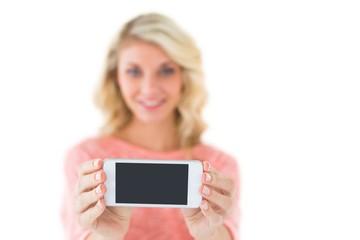 Pretty blonde showing her smartphone