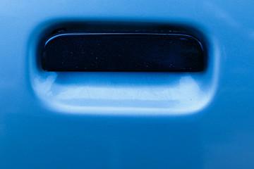 Blue car door handle