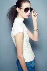 Eyewear concept. Fashionable beautiful young woman in sunglasses