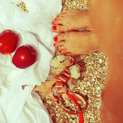 Summer picnic concept. Feet of standing woman in trendy dress