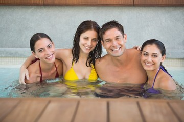 Cheerful people in the swimming pool