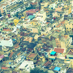 retro style  image of colorful homes in crowded Indian city Tri