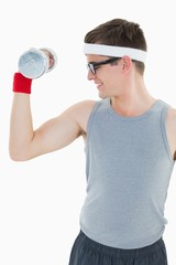 Nerdy hipster lifting heavy dumbbell