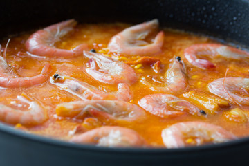 Cooking of traditional spanish seafood paella