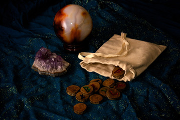 fortune telling with runes amethyst and crystal ball