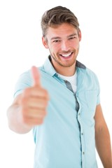 Handsome young man showing thumbs up to camera