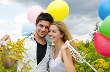 Young couple in love with colorful balloons :)