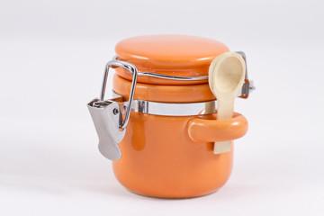 Ceramic orange salt shaker with a lid