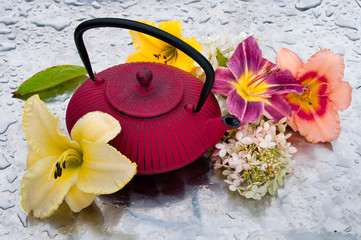 tea ceremony: tea pot with flowers on a rainy day
