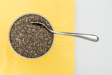 Bowl of dried chia seeds with a spoon