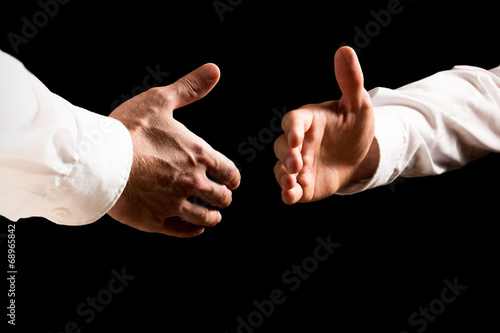 canvas print picture Businessmen about to shake hands