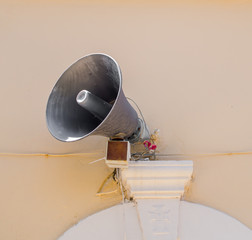 Loud speaker mounted on outdoor wall